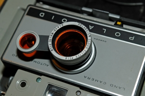 """Attaching the cloud filter to the Model 230. The metal """"filgers"""" are on the inside of the black ring that fits over the lens housing."""