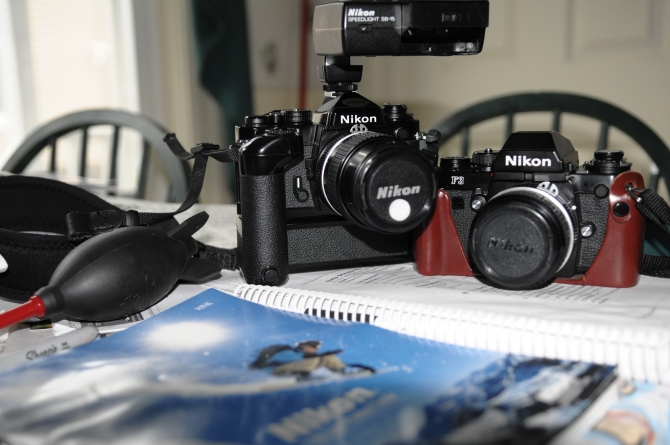Nikon FE-2, With MB-12, SB-15 Speedlight, 105mm f/2.5, With F3, Everready Case, And 50mm f/1.8 Ai.