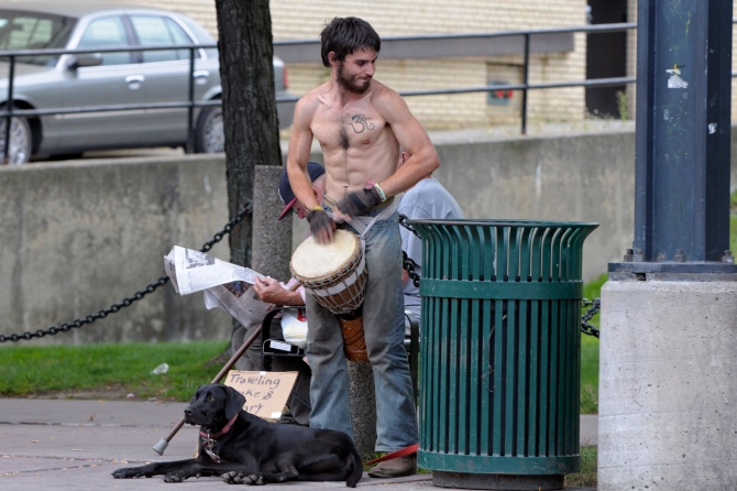 """This guy apparently had the money for tattoos, but has to play the drums for cash. Maybe he """"needs"""" more of them?"""