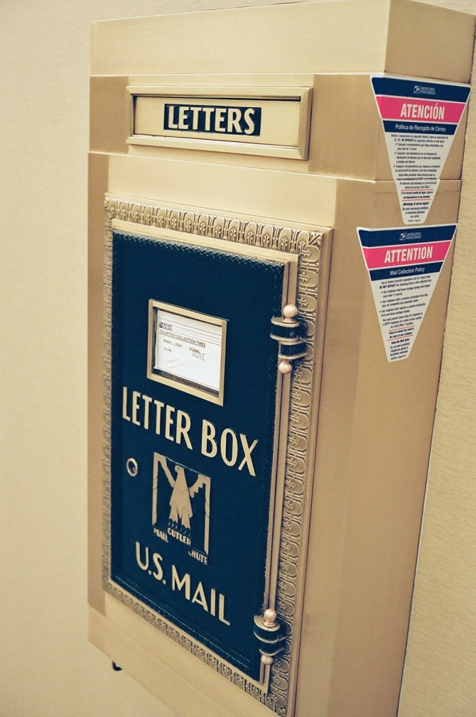 Vintage mailbox, in an office building lobby.